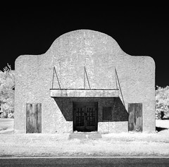 Langdon Theater (unknown quantity) Tags: sky grass shadows blackandwhite boardedupwindows fadedsign abandonedbusiness trees street monochrome weathered corrugated hss