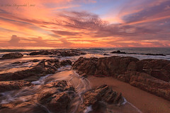 Sunset on the rocks (Pete 5D...©...) Tags: sunset coastline horizon dusk skies clouds sea reflection water rock rocks boulder boulders motion waves wave ripple formation tranquil