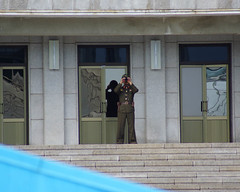 A North Korean Soldier observes visitors to the Joint Security Area. (H.E.A.R.T. Productions) Tags: public complete pajusi gyeonggido southkorea kr
