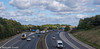 The M11 (M C Smith) Tags: pentax k3ii motorway m11 blue clouds white slope grass green bend traffic trucks van lines signs bridge barrires cars lamp chevrons sliproads