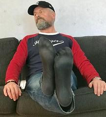 Black feets. (silvpix) Tags: beard jeans worn cap footsoles soles socks male man guy barefeet barefoot