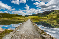 Llyn Llydaw Causeway (Adrian Evans Photography) Tags: track path minerstrack snowdonia landscape pygpath water llynllydaw cwmdyli mountains august outdoor lake landmark welshlandscape clouds reflections causeway minerspath summer wales pygtrack uk adrianevans northwales trail sky gwynedd stone snowdonianationalpark penypass cymru 20mm nikon d800