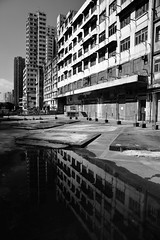 Yue Man Square Podium (superzookeeper) Tags: canoneos5dmarkiv ef2470mmf28liiusm 5dmk4 5dmkiv hk hongkong eos digital abandoned ruins kwuntong yuemansquare bnw blackandwhite monochrome reflection water street oldbuilding