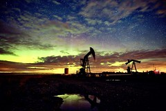 Pumpjacks on Big Hill Springs road (John Andersen (JPAndersen images)) Tags: alberta aurora night sky oilwell clouds stars