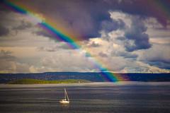 UNDER THE RAINBOW (RANNVEIG T) Tags: sea water boat rainbow rain sun oslo norway dark sky