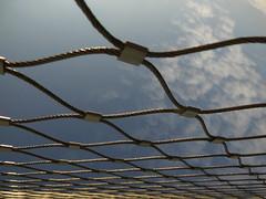 Holes in a Row (Ed Sax) Tags: netz sicherheit hvv hamburg edsax abstrakt modernart modern art photoart photokunst öpnv netzwerk ngc draht geflecht muster