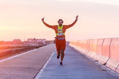 Sunrise Ragnar runner (lomokev) Tags: orange ragnar runner seawall sport sunrise camber england unitedkingdom gb file:name=1709245dmrk32347 canoneos5d canon eos 5d dof depthoffield focus running