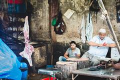 The butcher and the apple (lenguaphile) Tags: india bombay mumbai maharashtra streetphotography socialdocumentaryphotography streetbutcher leonardallen ldaiiiphotography