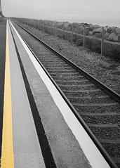 Mind the Gap! (Wendy:) Tags: kilcoole beach october platform yellowline mindthegap railway station singletrack selectivecolour photoshop
