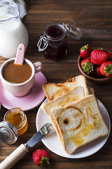 Breakfast with coffee, toasts, strawberry and jam (lyule4ik) Tags: coffee bread breakfast jam cup morning healthy spoon toast butter bited cheese cherry confiture continental cream light milk newspaper retro sandwich sugar sunny tinted toned drink homemade marmalade orange sweet toasts traditional turkish espresso apricot aromatic beverage energy froth good health home rustic up wake wheat white whole wholewheat wood