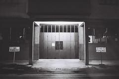 Well Lit (Explored) (OzGFK) Tags: asia singapore jalanbesar shop warehouse factory film analog nikon nikkor 35mm bw blackandwhite monochrome streetphotography urban night shutterdoor