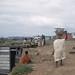 Girls carry canoe caught fish Accra cliff agarea lizards