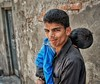 Father carries sleeping son (Pejasar) Tags: rajasthan ruralarea india completelyrelaxed care man portrait parenting responsibility carried sleeping boy child son father
