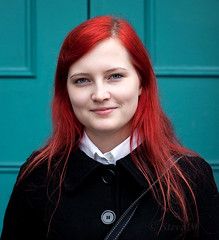 Viktoria-Debora - stranger 109/200 (englishreader) Tags: 100strangers strangers strangerphotography stranger peoplephotography people person streetphotography street portrait portraiture portraitphotography headshot female younglady lady woman women girl girls youngwoman redhead redhair longhair coat blackcoat buttons door turquoise turquoisedoor daylight availablelight naturallight 50mmlens primelens