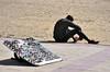 In attesa di un futuro migliore (Maurizio Belisario) Tags: venditore occhiali glasses spiaggia beach nero extracomunitario solitudine alone black africa ambulante seller