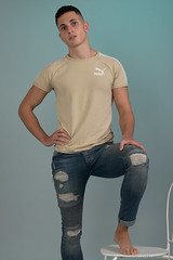 Dominic (PhotoMechanic.uk) Tags: male man guy dude youth model pose photoshoot boy studio jeans tshirt fashion trendy casual green blue chair foot feet barefoot