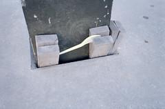 Untitled (Florian Thein) Tags: berlin mitte gabel keile holzkeile beton concrete fork eingeklemmt geklemmt plastikgabel film analog 35mm yashicat5 kleinbild kodakgold