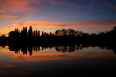 Evening silhouettes on the lake (Yarin Asanth) Tags: evening paddling lake reflections surface calmwater dark sky red afterglow sundown lakeconstance yarinasanth gerdkozik
