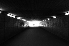 Light At The End Of The Tunnel (CoolMcFlash) Tags: silhouette contrast blackandwhite bnw bw blackwhite street streetphotography candid tunnel light shadow canon eos 60d munich germany kontur kontrast sw schwarzweis licht schatten dark dunkel münchen deutschland fotografie photography person bicycle cycling rad fahrrad sigma 1020mm 35 city stadt