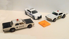 Cheez-It, the Cops! (splattergraphics) Tags: 1968 plymouth fury 1970 oldsmobile 442 olds 2011 dodge charger policecar policecruiser model diecast hotwheels matchbox 164scale