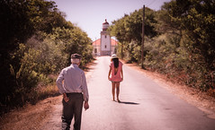 Looking back (amcatena) Tags: trees red people travel road green portugal tress lighhouse gravel algarve