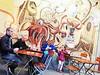 Berlin Street Coffee (kirstiecat) Tags: berlin germany people strangers beautifulstrangers mural street streetart coffee octopus moment cinematic kid child parents