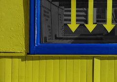 down for yellow (lowooley.) Tags: broadstairs kent southeastengland shop yellow blue window arrows explored