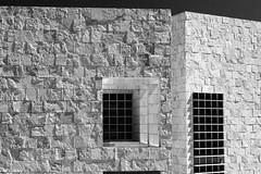 Windows in Stone (Thad Zajdowicz) Tags: zajdowicz losangeles california usa thegettycenter gettyinspired canon eos 5dmarkiii dslr digital availablelight lightroom ef24105mmf4lisusm architecture building wall windows stone glass blackandwhite bw black white monochrome highcontrast texture pattern