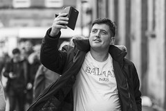 Pleased with himself (Frank Fullard) Tags: frankfullard fullard candid street portrait pleased satisfied selfie photographer smile monochrome face ballinasloe horsefair happy blackandwhite noir irish ireland humble perfect song love selflovemirror