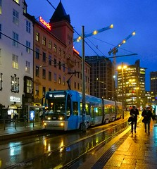 Not many people in Oslo a rainy afternoon ☔. (evakongshavn) Tags: urbanlife tram trikk urban urbanphotography streetphotography streetview street blue photography afternoonlight oslos city citylife oslo visitoslo norge norway visitnorway rainyday rain heavyrain travelawsome travel travelplanet tourist turistiegenby downtown mood moody atmosphere