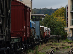 Last goods train to nowhere (wi-fli) Tags: lenstagger bristol england unitedkingdom train rails railway wagon wagons rollingstock derelict harbourside grass tracks sleepers rail apartments sky urban spikeisland harbour docks dockside waterfront helios adapted legacy manualfocus
