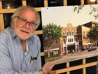 GableStage Theater artistic director Joe Adler with the renderings for the new planned Coconut Grove Play house