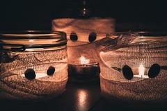 HMM: Halloween Mummies (donnicky) Tags: halloween macromondays blackbackground candle closeup dof holiday indoors light macro mummy nopeople publicsec fire