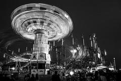 Night Spinner (TheAgeOfAnalog) Tags: olympus om2n slr film ferrania p30 rodinal 35mm f28 zuiko tulsa state fair night spinner ride amusement lights long exposure believeinfilm oklahoma