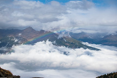 When the rainbow waits for you down there (Vagabundina) Tags: alps mountains rifugioarbolle nature scenery landscape clouds sun rainbow morning autumn aosta valdaosta nikon nikond5300 dsrl