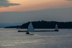 Burlington Breakwater North Light (John H Bowman) Tags: newengland vermont chittendencounty burlington parks localparks lighthouses newenglandlighthouses vermontlighthouses burlingtonbreakwaternorthlight lakesandponds lakechamplain boats sailboats cloudyskies sunsets afterglow september2017 september 2017 canon702004l