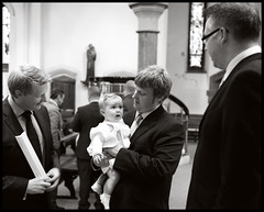 A christening worry (gerard47421) Tags: nikond700 naturallight church blackandwhite christening baptism