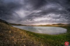 Storm is coming.. (Kasia Sokulska (KasiaBasic)) Tags: fujix canada alberta bisonpaddocklooproad waterton landscape rockymountains rockies mountains summer nature rain clouds lake prairies
