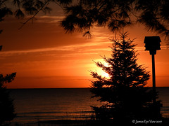 Huron Sunrise (JamesEyeViewPhotography) Tags: michigan northernmichigan water greatlakes lake huron sunrise fall autumn sky clouds trees waves