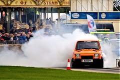 Steam Riding... (Fuffle & Snap) Tags: fiat 126 burn off orange drg racing sywell aerodrome team taz crousel vintage fairground