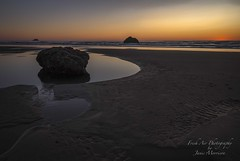 Sun just touching the horizon for the last time today - Hug Point, Oregon (Freshairphotography) Tags: oregon oregoncoast sunset sun sunlight pacificocean ocean rocksandwater reflections beach hugpoint glow colorful coast colors evening intertidal light lowtide peaceful serene