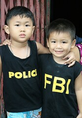 inter-agency cooperation (the foreign photographer - ฝรั่งถ่) Tags: interagency cooperation two boys police fbi khlong thanon portraits bangkhen bangkok thailand canon