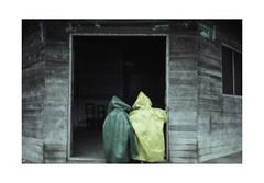 Rainy day.  ( Rurrenabaque ) 1991 (José Luis Cosme Giral) Tags: rainyday twokids travel amazon nikon scanned rurrenabaque bolivia 1991 street