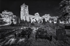 Waiting in the shadows (David Feuerhelm) Tags: nikkor blackandwhite bw noiretblanc schwarzundweiss contrast ethereal church tower infrared ir wideangle churchyard cemetery tombstone graves gravestones swavesey outdoors old history historic cambridgeshire nikon d90 sigma1020mm