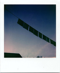Prayer Flags at Sunset (m.ashe7) Tags: onestep2 polaroid polaroidoriginals outdoors minimalist prayerflags sunset dark moody sky
