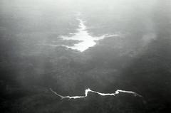 "reflecting [analog] (__J) Tags: reflection reflektion lake see river fluss water landscape landschaft canona1 a1 canon canonfd 50mm canonfd50mm18 film analog scanned scan analogue blackandwhite schwarzweis sw bw monochrome monochrom ""kodak tmax 400"" tmax"" ""iso kodak professional ""tmax"" ""tmax fromaplane planewindow flugzeug airplane"