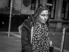 Feline Good (Leanne Boulton) Tags: portrait urban street candid portraiture streetphotography candidstreetphotography candidportrait streetportrait streetlife woman female girl face facial expression eyes look emotion feeling mood feline cat costume cosplay makeup halloween tone texture detail depthoffield bokeh naturallight dutchangle outdoor light shade shadow city scene human life living humanity society culture canon canon5d 5dmkiii 70mm ef2470mmf28liiusm black white blackwhite bw mono blackandwhite monochrome glasgow scotland uk