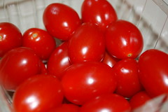 Tomatoes In A Container.