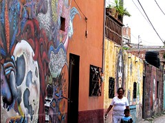 Wall art everywhere (thomasgorman1) Tags: grafitti walls buildings people town mexico street streetphotos canon woman child colors public candid painting paint art wallart alley