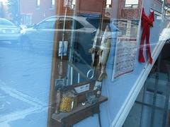 Gone Fishing (navejo) Tags: montreal quebec canada fish mirror bow ribbon window calendar